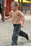 Active child. Child running in the park to meet his friends Stock Photo