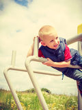 Active child kid having fun in playground. Royalty Free Stock Image