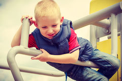 Active child kid having fun in playground. Stock Photo