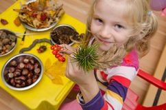 Active child making autumn decorations. Active kid with autumn craftsmaship activities and hobbies Stock Photo