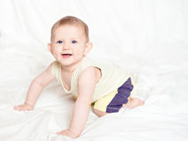 Active child 6 months crawl low. Royalty Free Stock Photography