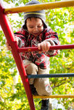 Active child in playground. Climbing some stairs structure Royalty Free Stock Image