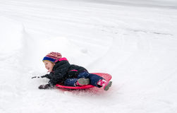 Active child playing in the snow Stock Photo