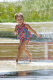 Active child running in fountain Stock Photos