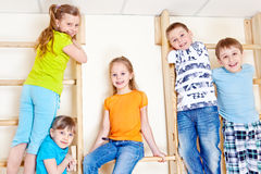 Active children. Climbing up the gymnastic wall bars royalty free stock photos