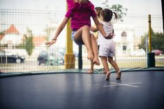 Active children. Three little kids playing on trampoline. Close up. Copy space stock image