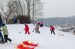 Active children fun in winter on hill with sledge Royalty Free Stock Photography