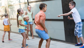 Active children playing charades outdoors Royalty Free Stock Images