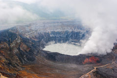 Active Costa Rica Volcano. View of the caldera of the Costa Rican volcano known as Poas.  Steam is rising up from the discolored crater and gray lake Stock Images