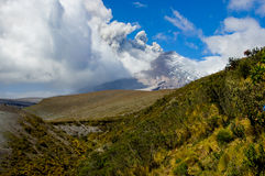 Active Cotopaxi volcano erupting. COTOPAXI, ECUADOR - AUGUST 26, 2015: Beautiful view of magnificent Cotopaxi volcano erupting in Ecuador, South America Royalty Free Stock Images