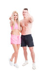 Active couple of fitness trainers or instructors. Showing like and smiling isolated on white Stock Photos