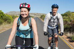 Active couple going for a bike ride in the countryside Royalty Free Stock Image