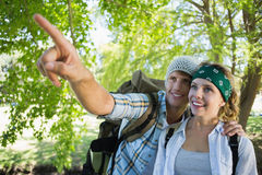 Active couple on a hike with man pointing Stock Photography