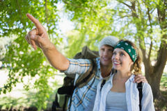 Active couple on a hike with man pointing Royalty Free Stock Images