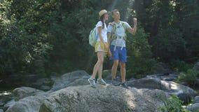 Cheerful couple of hikes enjoying panaromic view stock footage