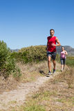 Active couple jogging on country terrain Stock Photography