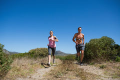 Active couple jogging in the countryside Royalty Free Stock Images