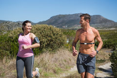 Active couple jogging in the countryside Stock Photos