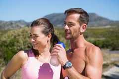 Active couple jogging in the countryside Stock Images
