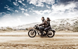 Active couple on the motobike Royalty Free Stock Photography