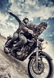 Active couple on motorcycle Stock Photos