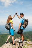 Active couple rests after biking on a mountain top Royalty Free Stock Image