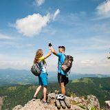 Active couple rests after biking on a mountain top stock images