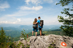 Active couple rests after biking on a mountain top Stock Image