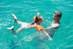 Active couple at sea beach with snorkel  set Stock Image
