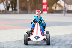 Active cute boy having fun with toy race cars Stock Image