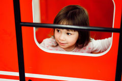Active cute little girl on playground Royalty Free Stock Photo