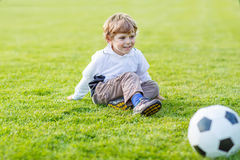 Active cute little kid boy playing soccer Stock Photography