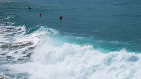 Active day at a Dominican beach. With waves, swimmers, and wind stock image