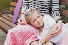 Exhausted daughter lying on her mother after active day royalty free stock photos