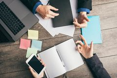 Active discussion of business development strategy of business. Analytics and planning. Top view working place desk royalty free stock photo