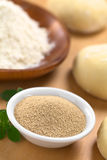 Active Dry Yeast. In small bowl with fresh oregano, flour and dough (Selective Focus, Focus in the middle of the dry yeast Stock Photo