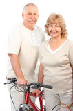 Active elderly couple. Isolated over white backfround royalty free stock photography