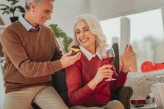 Active elderly couple celebrating Saint Valentines Day. In love. Portrait of active smiling elderly couple celebrating Saint Valentines Day while positive men royalty free stock photo