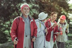 Active elderly man enjoying hiking in mountains. Life after retirement. An active elderly men enjoying hiking in mountains stock photo