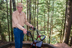 Active Elderly Man with Walker in Forest. Active senior white male on a hike with a walker in old growth evergreen forest on Deception Falls Nature Trail in stock images