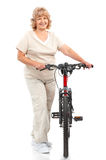 Active elderly woman. Isolated over white background royalty free stock images