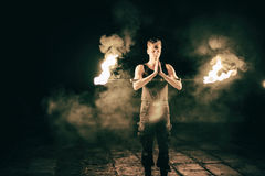 Active European guy carries out tricks for fire show night Stock Photography
