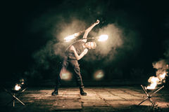 Active European guy carries out tricks for fire show night Royalty Free Stock Photography