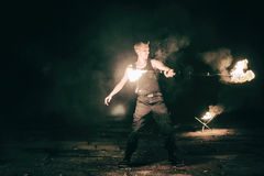 Active European guy carries out tricks for fire show night Royalty Free Stock Photos