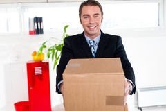 Active executive carrying packed carton Stock Photos