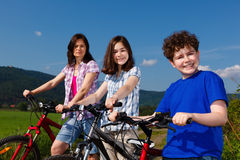 Active family. Family riding bikes in rural scenery Stock Images