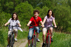 Active family. Family riding bikes in rural scenery Stock Image