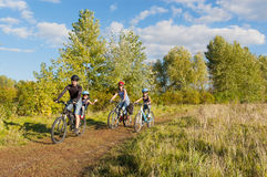 Active family on bikes cycling outdoors Royalty Free Stock Photos