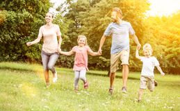 Active family with children. Making sport in the nature royalty free stock images