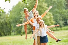 Active family and children have fun together. In nature on vacation stock photo